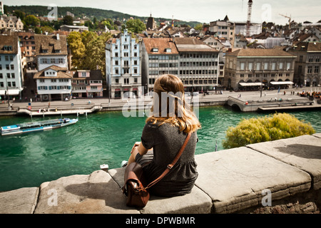A young woman sightseeing beautiful view of Zurich, Switzerland - Stock Photo