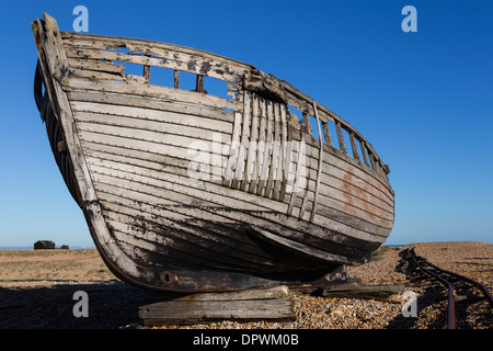 Derelict Abandoned Boat on Dungeness Beach - Stock Photo