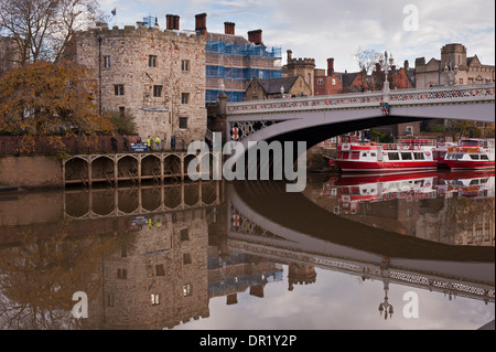 Lendal Bridge, stone Tower & moored city cruise boats reflected in water & seen from south bank of River Ouse - - Stock Photo