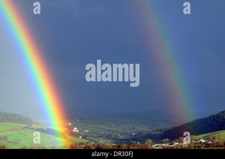 Aberystwyth, Wales, UK. 18th Jan, 2014.  For the second time in two days, a rainbow crosses the view of the Cambrian - Stock Photo