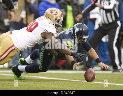 Seattle, WA, USA - San Francisco 49ers outside linebacker Aldon Smith (99) goes after the ball on the first play - Stock Photo