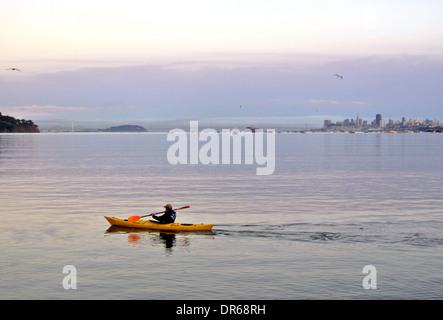 man kayaks on san Francisco bay in Marin County California - Stock Photo