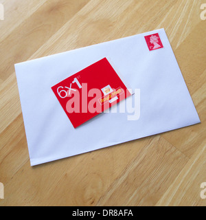 Book of First Class Royal Mail Stamps and Envelope, UK - Stock Photo