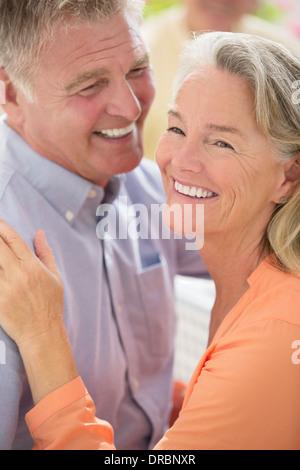 Happy senior couple hugging - Stock Photo