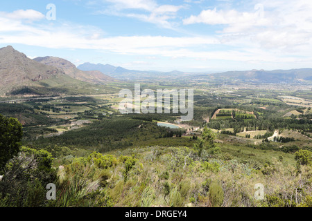 Paarl and surrounding farmland and mountains, viewed from Dutoitskloof pass, with Paarl Rock in the background - Stock Photo