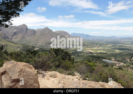 Paarl and surrounding farmland and mountains, viewed from Dutoitskloof pass - Stock Photo