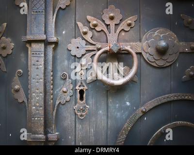 Ornate ironmongery fittings on old door of St Peter's church Hampton Lucy Warwickshire UK - Stock Photo