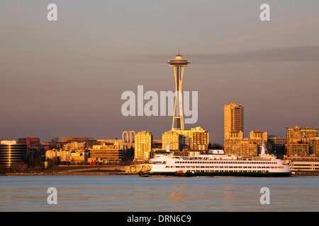 WASHINGTON - The Space Needle and a Cross-Sound ferry boat in Elliott Bay at sunset from West Seattle. - Stock Photo