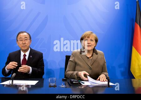 Berlin, Germany. 30th Jan, 2014. German Chancellor Angela Merkel (R) and UN Secretary-General Ban Ki-Moon attend - Stock Photo