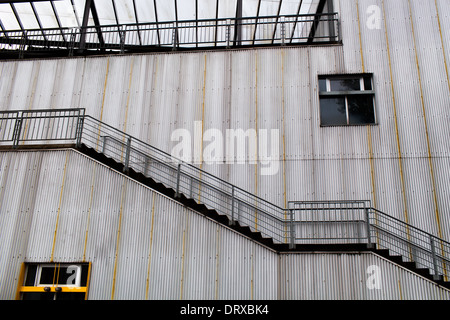 Photograph of Building with Corrugated Steel Wall with a Stairway on Granville Island, Vancouver, British Columbia. - Stock Photo