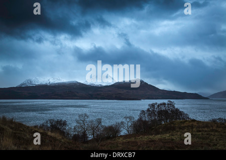 Snow covered summit of Beinn Sgritheall across the Sound of Sleat, Isle of Skye - Stock Photo