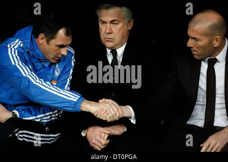 Madrid, Spain. 5th Feb, 2014. Carlo Ancelotti (C) and ZinÌÄ©dine Zidane during the Spanish King's Cup Semifinal, - Stock Photo
