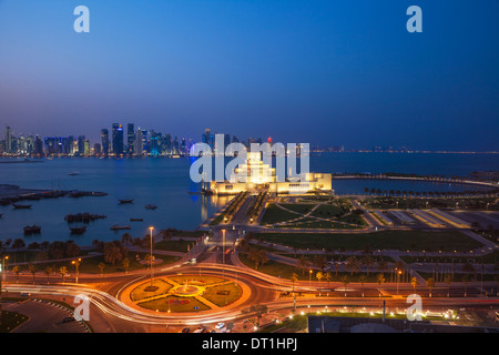 Traffic at roundabout in front of the Museum of Islamic Art at night, Doha, Qatar, Middle East - Stock Photo