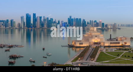 Museum of Islamic Art with West Bay skyscrapers in background, Doha, Qatar, Middle East - Stock Photo