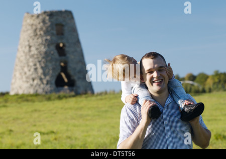 Happy young father and son playing together - Stock Photo