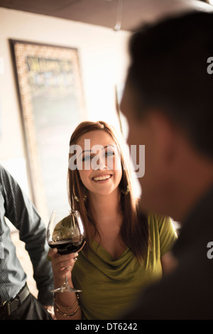 Business colleagues in wine bar - Stock Photo