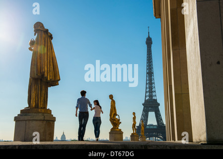Young couple strolling near Eiffel Tower, Paris, France - Stock Photo