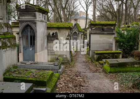 View of one of the lanes in Pere Lachaise, the largest Cemetery in Paris, France. - Stock Photo