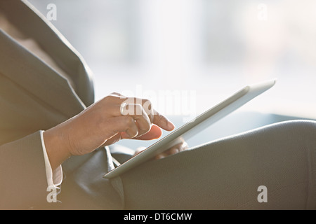 Businesswoman using digital tablet, close up - Stock Photo