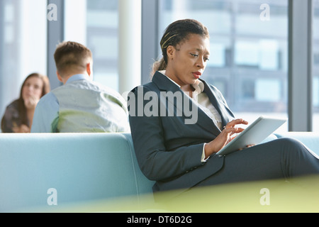 Businesswoman using digital tablet - Stock Photo