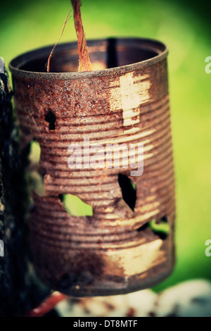 Rusty can on a wire - Stock Photo