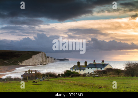 Stormy sunrise at cuckmere haven East Sussex, looking towards the Sussex coast guard cottages and the seven sister - Stock Photo