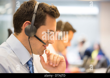 Businessman talking in the micro operator in the office - Stock Photo