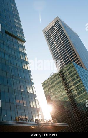 Early morning sunburst on midtown skyscrapers, 42nd St Midtown Manhattan New York City, USA - Stock Photo