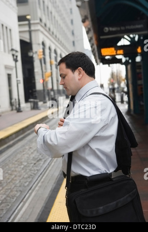 Businessman commuting to work - Stock Photo