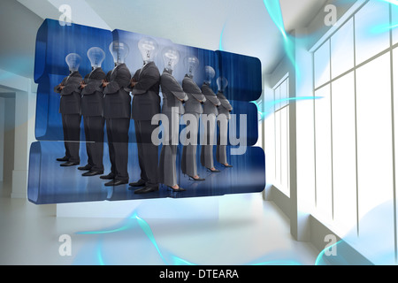 Composite image of light bulb business people on abstract screen - Stock Photo