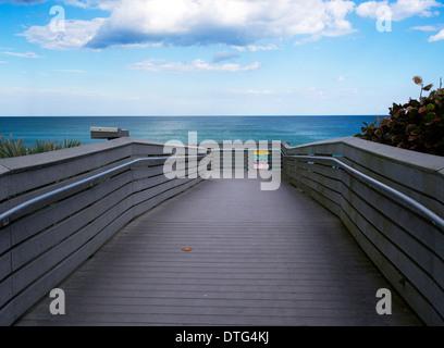 Bridge over the dunes onto Melbourne Beach in Florida - Stock Photo