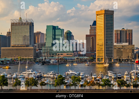 The Baltimore Inner Harbor Skyline shortly before sunset, as viewed from Federal Hill in Baltimore, Maryland. - Stock Photo