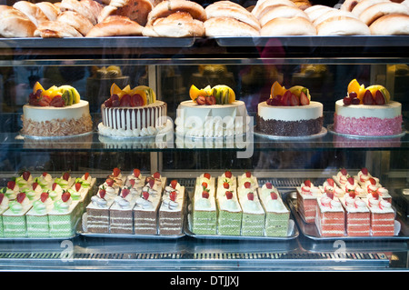 Cakes in a window at Kowloon Restaurant and Bakery, Chinatown, Soho, London, WC2, UK - Stock Photo