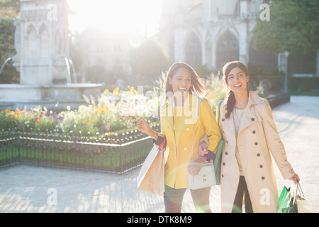 Women walking in urban park - Stock Photo