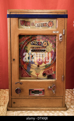Bryans vintage ALLWIN arcade slot machine _Allwin polo machines _'Win a Polo' Antique Slot Machine on Stand - Stock Photo