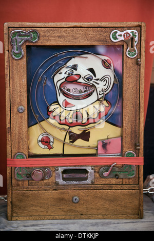 Bryans vintage ALLWIN arcade slot machine _1p Antique  'Clown faced' Slot Machine on Stand. - Stock Photo