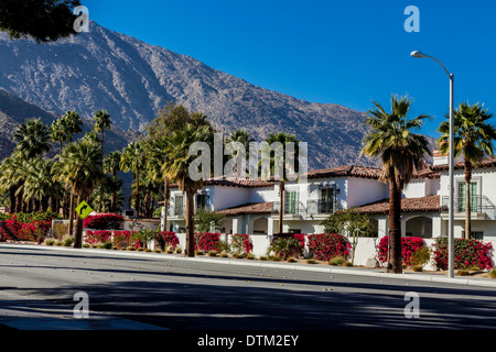 Condominiums bedecked with Bougainvillea in Palm Springs California February 2014 on Palm Canyon Drive - Stock Photo