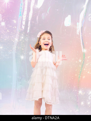Cute little girl stucked in the large soap bubble - Stock Photo