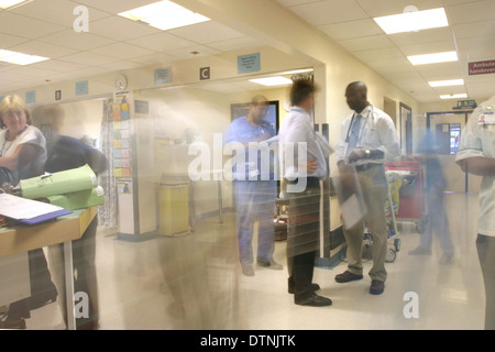 Very busy and chaotic Accident and Emergency department in a UK NHS district hospital, showing doctors and nurses - Stock Photo