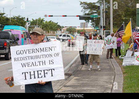 Miami, Florida - Cuban exiles, members of the Tea Party, rally on a variety of issues. - Stock Photo