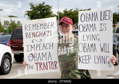 Cuban exiles, members of the Tea Party, rally on a variety of issues including the impeachment of President Obama. - Stock Photo