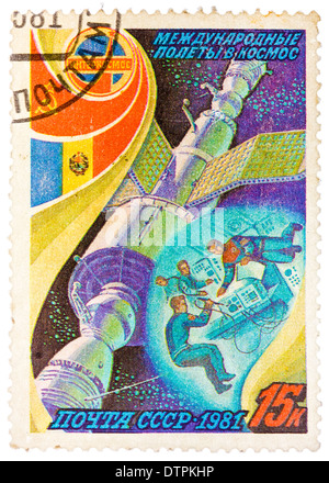 Stamp printed in The Soviet Union devoted to the international partnership between Soviet Union and Romania in space - Stock Photo