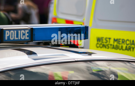 Blue light bar on top of a police car - Stock Photo