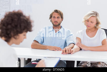 Psychologist taking notes - Stock Photo