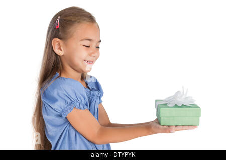 Blonde little girl giving a present - Stock Photo