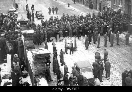 Officers of th People's Police in the Soviet occupation zone gather during a large-scale raid on the black market - Stock Photo