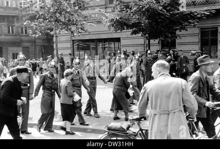 Officers of the People's Police form a chain during a large-scale raid on the black market in the Soviet occupation - Stock Photo