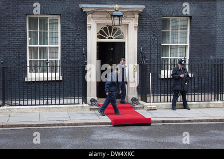 Westminster London, UK. 27th February 2014. Red carpet is rolled out for the official visit of German Chancellor - Stock Photo