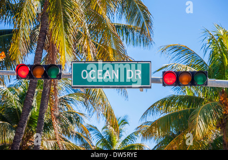 street sign of Ocean Drive in Miami South with traffic light - Stock Photo