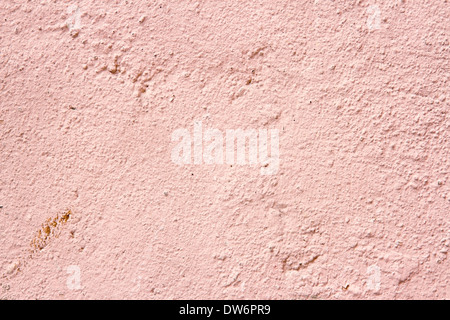 Plastered cream and pink color old cement wall background for copy space - Stock Photo